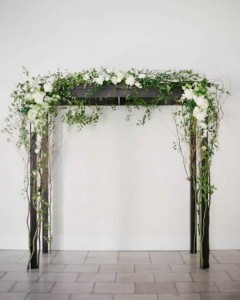 Arch with white flowers, greenery