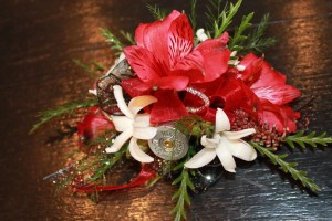 Corsage with lilies by EverBloom Floral and Gift in Omaha and Bellevue