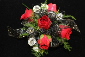 Corsage with red roses by EverBloom Floral and Gift in Omaha and Bellevue